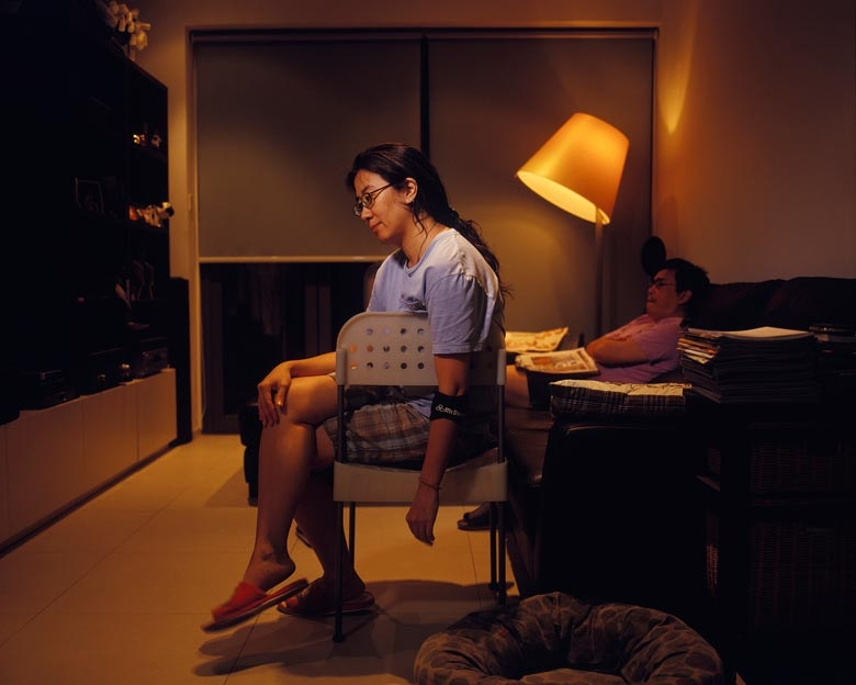 Magdelene sits in her living room in Kai Yuen Street, North Point.