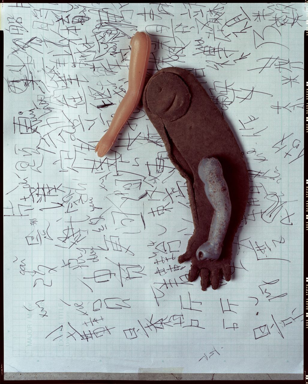 girl doll's left hand / collected 2003 <p>boy doll's right hand / collected 2002 <p>male figure's left hand / collected 2006 <p>Chinese writing homework by an oversea student / collected 2005