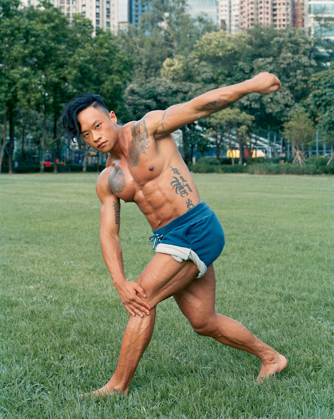 Victoria Park, Causeway Bay;   Siu Fung Law is a gender-queer bodybuilder, an educator, transgender scholar, genderqueer advocate and trans advocate, and active in the LGBTQ community. They identify Siu Fung as gender-non-conforming.