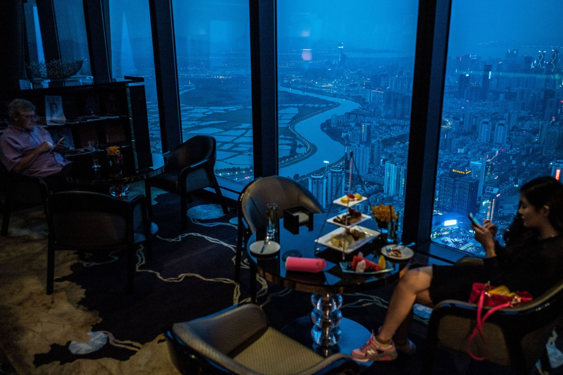 People have tea at a restaurant with view of the Hong Kong-China border on April 3, 2016 in Shenzhen, China. (Lam Yik Fei/Getty Images)