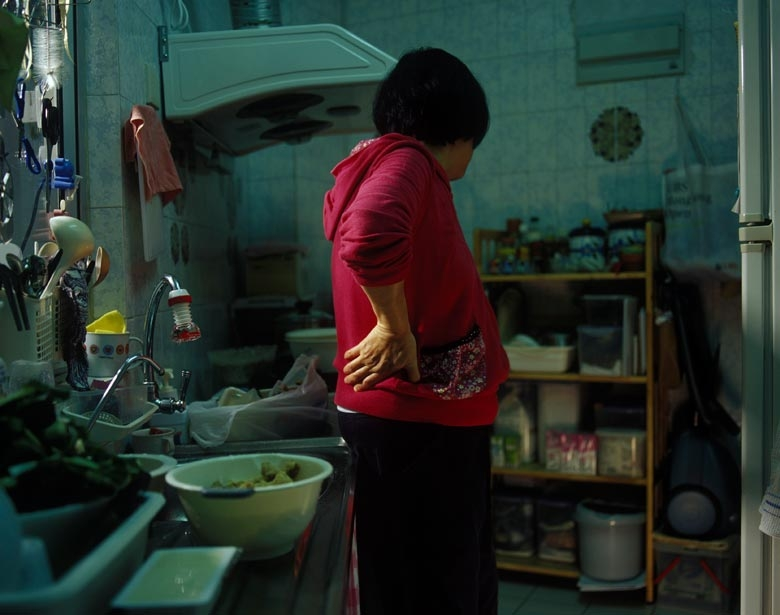 Mandy in her kitchen in the now demolished Lower Kai Yuen Lane, North Point.