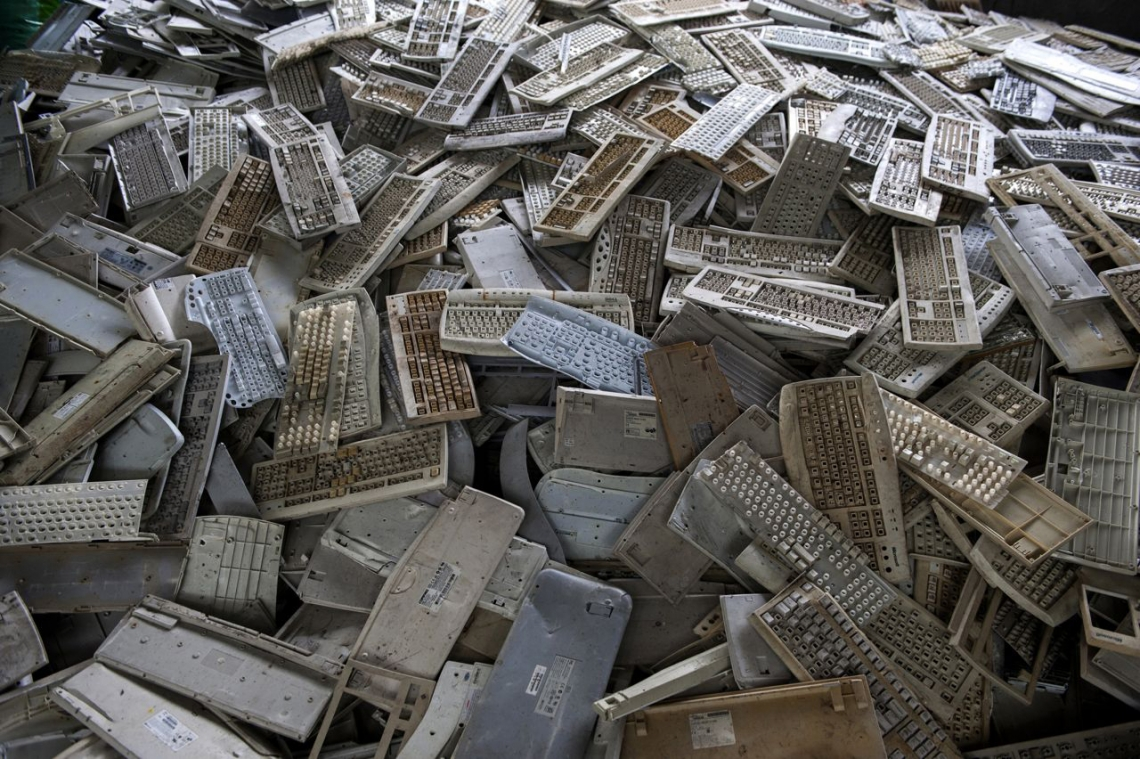 A mountain of outdated keyboards. Guiyu, China. May 2013.