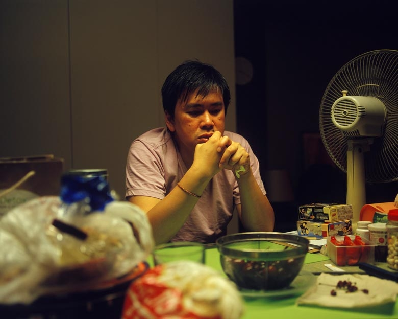 Zack, an entrepreneur, sits in his kitchen in Kai Yuen Street, North Point.