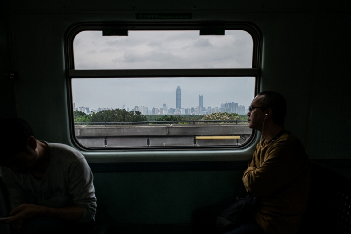 People take ride on a train from Sheung Shui to Lok Ma Chau on April 3, 2016 in Hong Kong. (Lam Yik Fei/Getty Images)