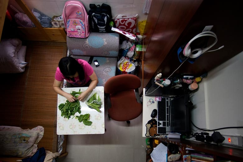 A family of four live in a subdivided flat in Tsuen Wan. The tenant and her children prefer to return to their spacious mainland home for vacation, 2012.  From the series 'Cents' Mansion.