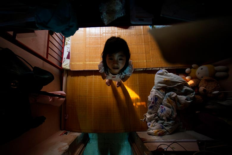 A rooftop house in Tsuen Wan (only 7 feet high) is under threat by dangerous centipedes and a potential ceiling collapse, 2012.  From the series 'Cents' Mansion.