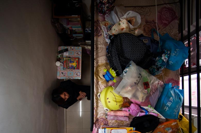 A sub-divided flat located just opposite the location of the Fa Yuen Street fire in 2011. The flat is immediately next to the back staircase of the building and is always blocked by items. Tenants worry that if there is a fire, they will be unable to escape, 2011.  From the series 'Cents' Mansion.