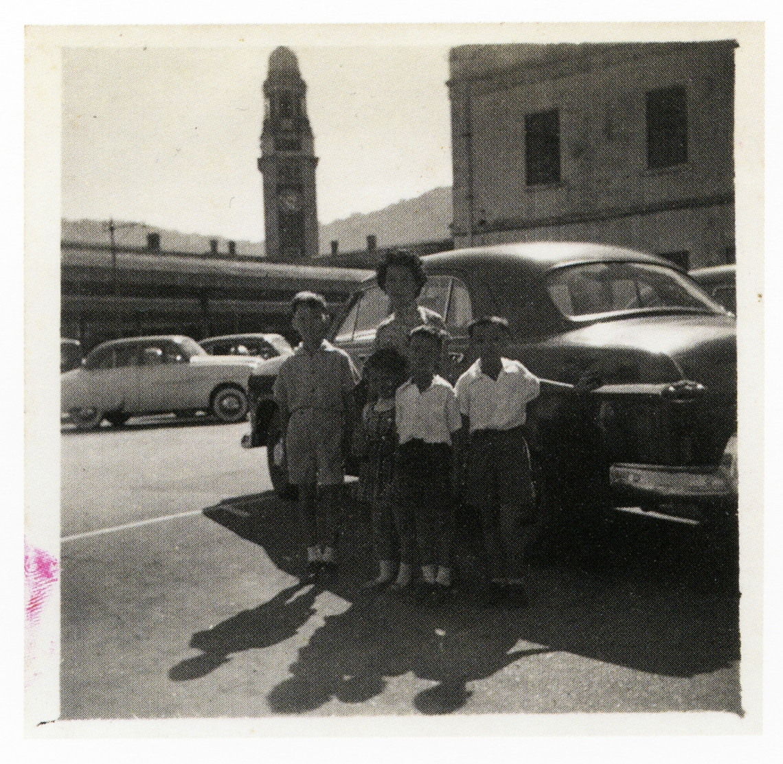 Newly arrived in Hong Kong. Posing next to a stranger's car, 1956