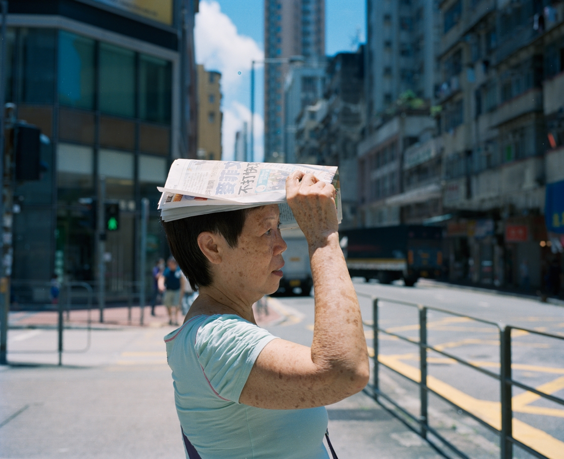 My yeema, who is 71, about to cross the street under the sun; Cheung Sha Wan, Kowloon.