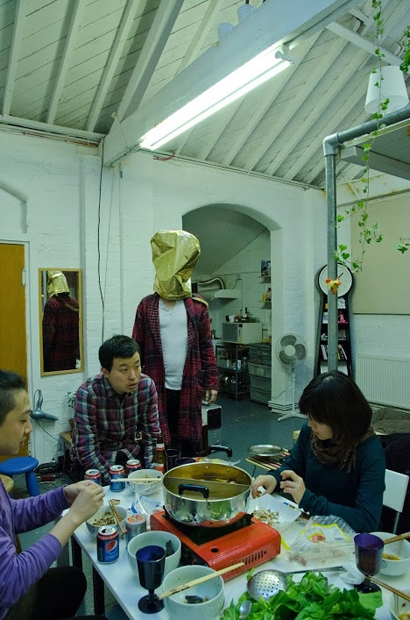 A Chinese hot pot party in northern London, Jeremy Lee, participant in The Big Mist project, shows his way of breathing.