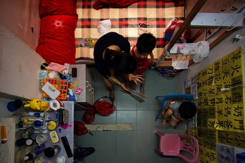 A family of four lives in a 100 sq. ft. mini-flat in Tsuen Wan. They hope to move into public housing soon, 2012.  From the series 'Cents' Mansion.